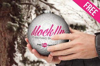 Free Christmas Ball Hand Hold Mock-up in PSD