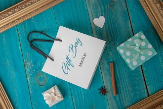 Free PSD Gift Bag Mockup on a Blue Background